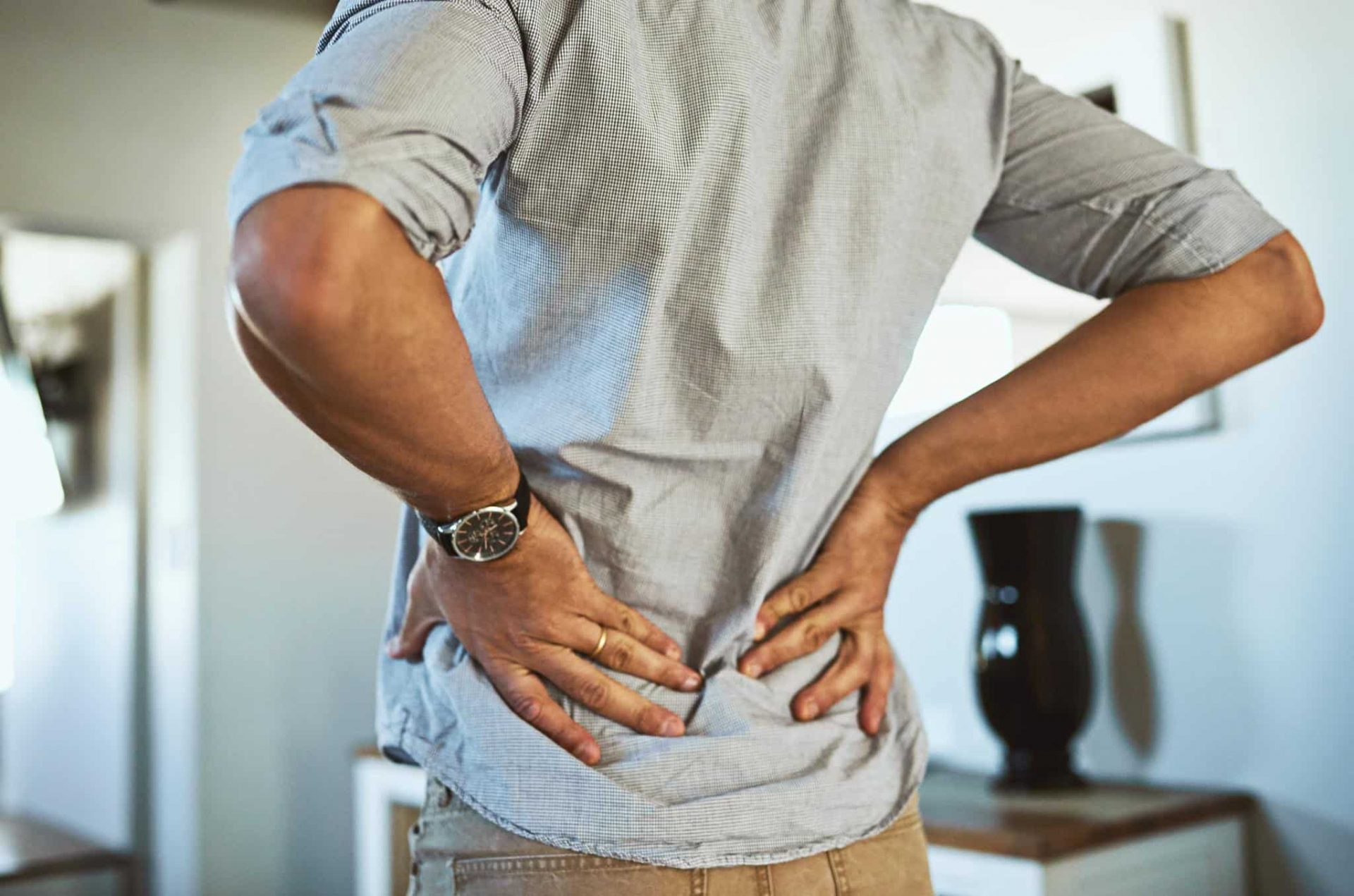 man with back pain who could take cbd oil to help