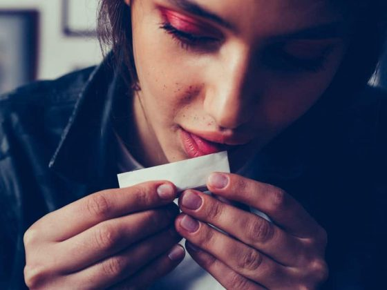 girl rolling joint