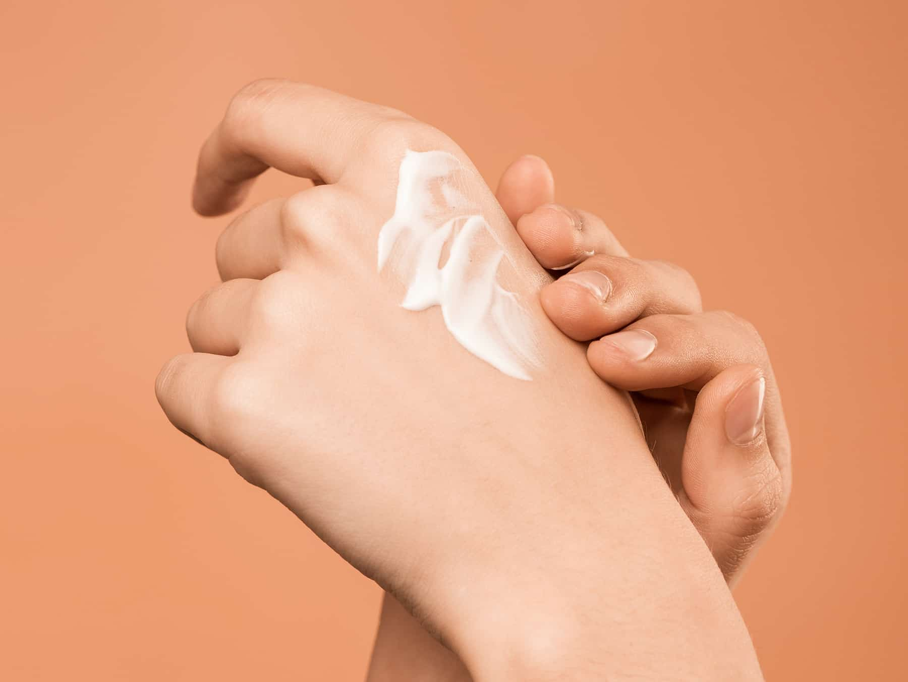cbd skin cream being rubbed into a hand