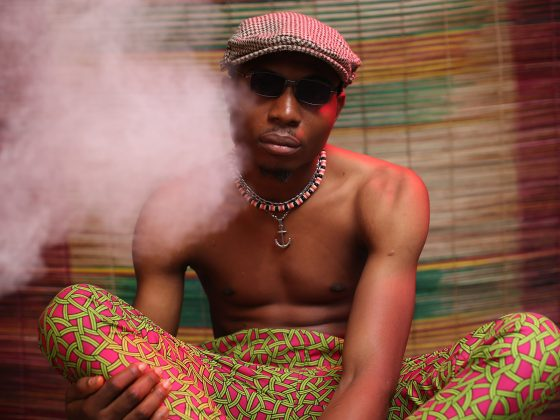 man listening to music while smoking cannabis