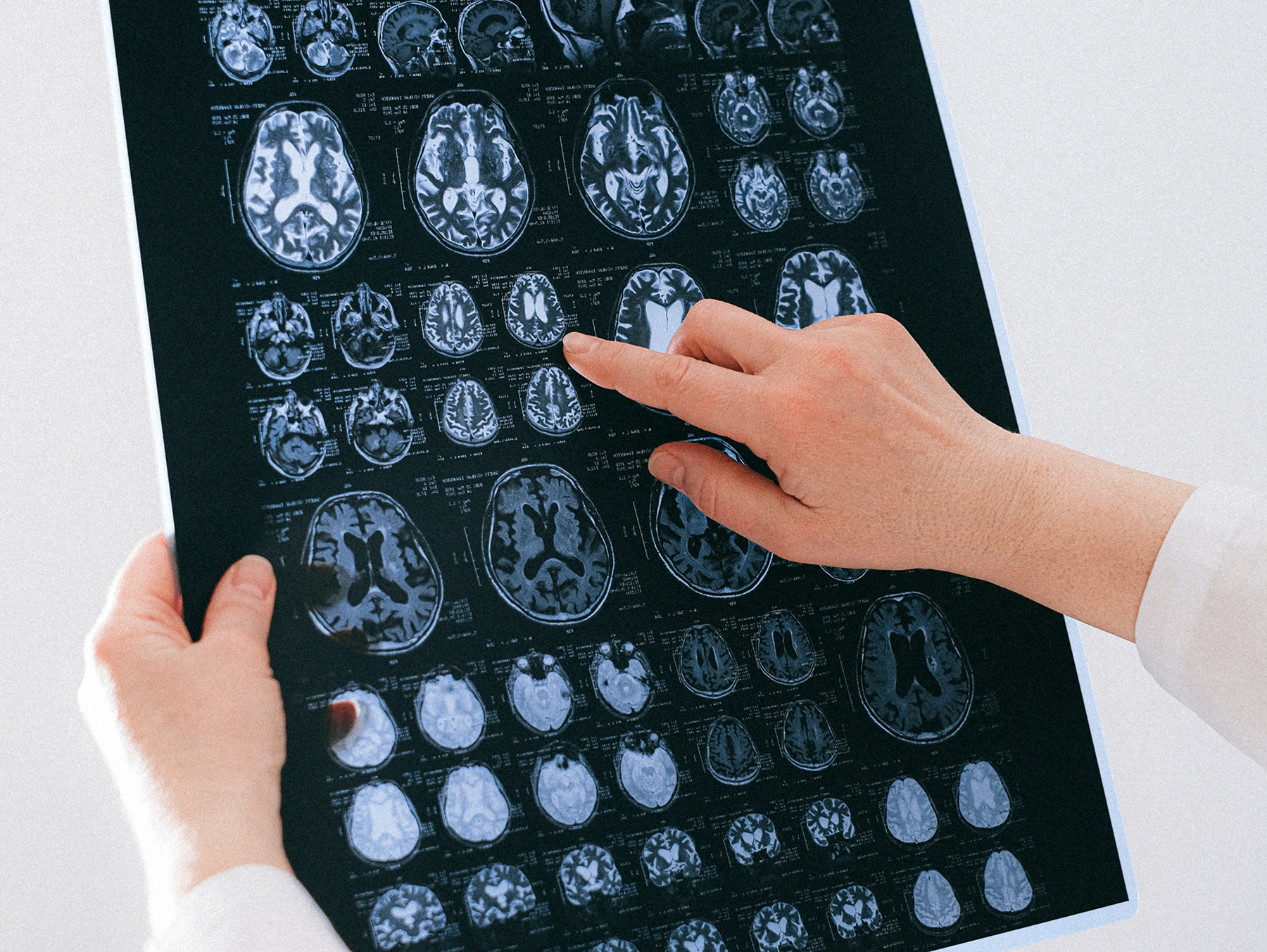 patient scan being examined by doctor