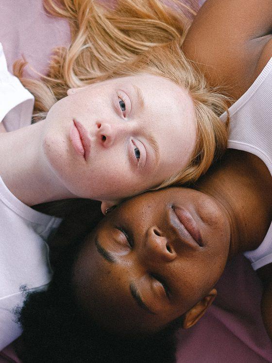 two women lying down