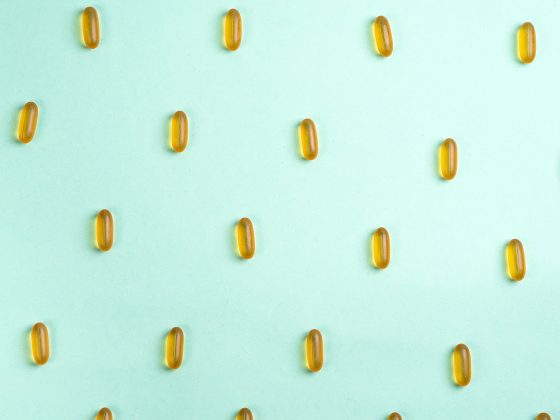 cbd capsules on a blue background