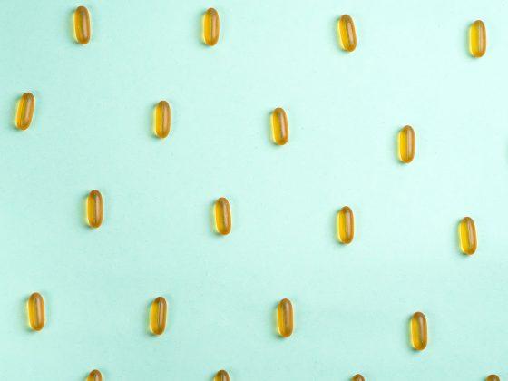 cbd capsules on a blue background