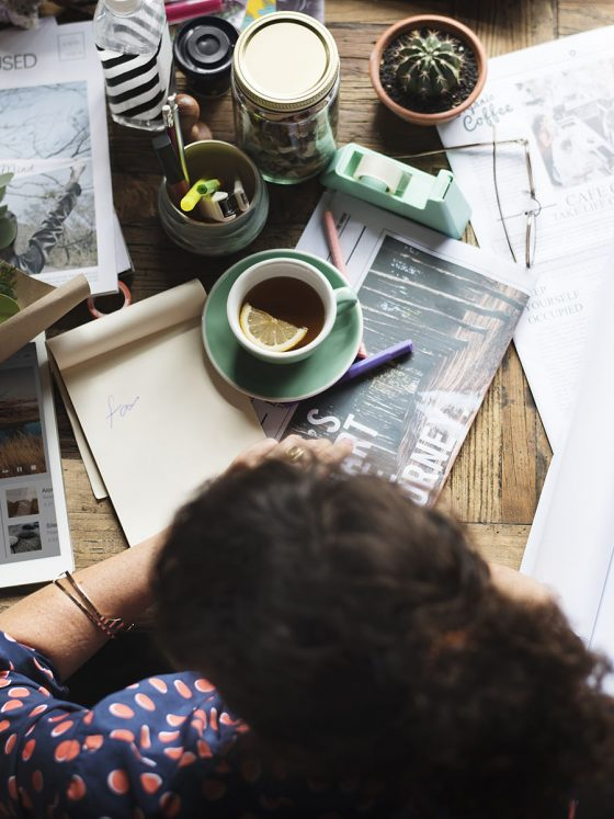 woman working from home with a messy desk