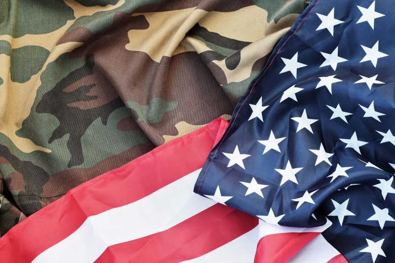 american flag and folded military uniform