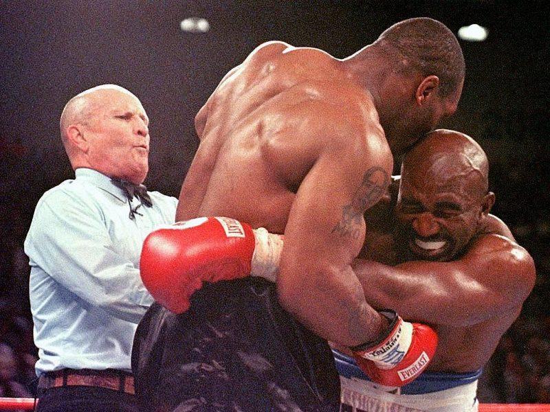 Mike Tyson biting ear of opponent