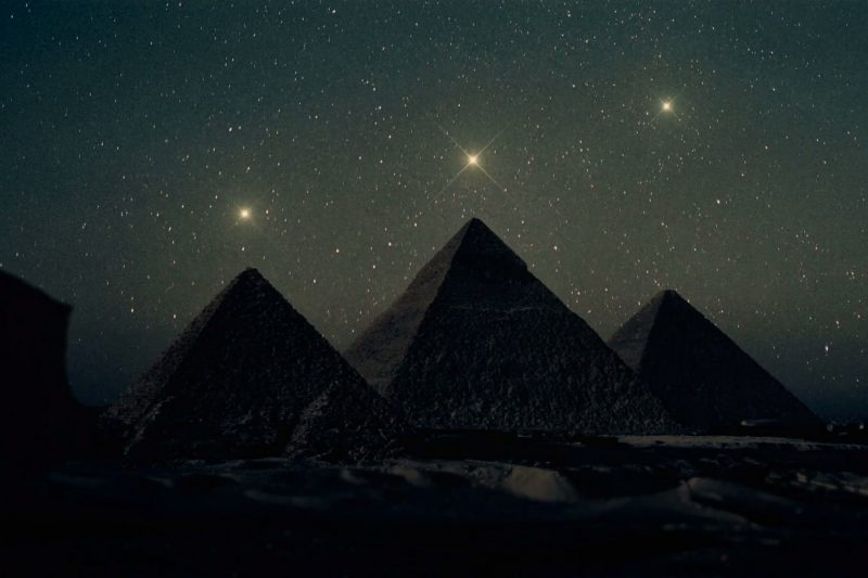stars aligning above the pyramids of giza in egypt