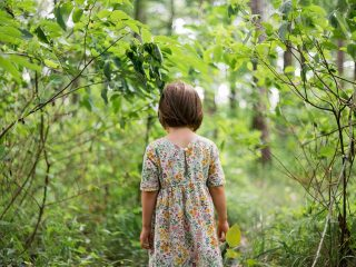 girl with autism stood in forest